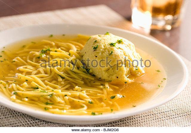 Matzoh Ball Soup with Pasta - Stock Image
