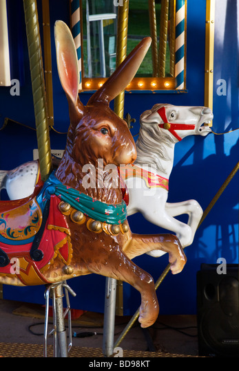 A rabbit and horse of a CAROUSEL in the BOSTON COMMON the park and garden completed in the year 1837 BOSTON MASSACHUSETTS - Stock Image