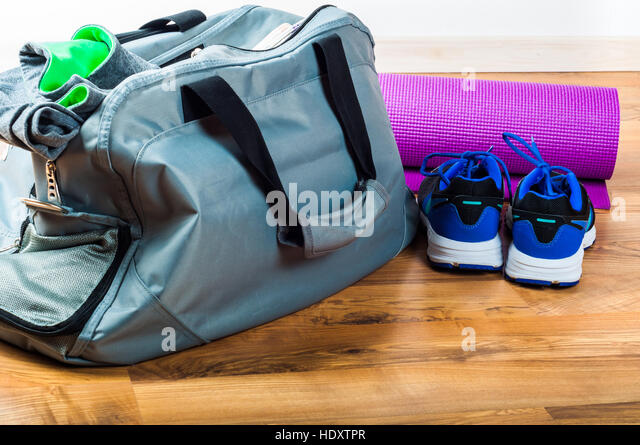 Sport bag on the wooden floor - Stock Image
