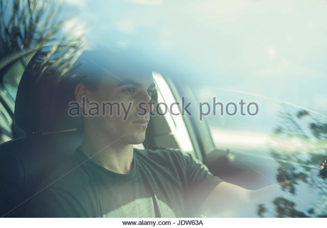 Young man driving car - Stock-Bilder
