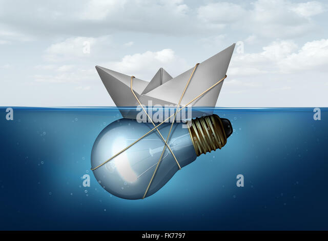 Business innovative solution and creative concept as a paper boat tied to a light bulb or lightbulb object as a - Stock Image