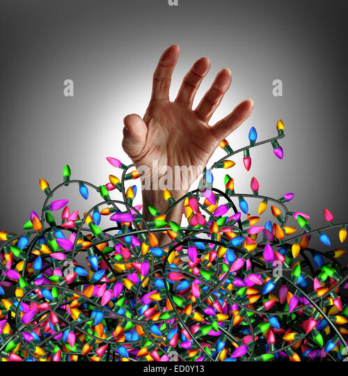 Holiday season stress concept as a human hand escaping from a chaotic tangled mess of three dimensional decoration - Stock-Bilder