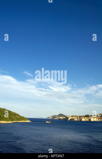 Approaching Dubrovnik from the sea, Dubrovnik city walls and the  The Island of Lokrum, Dalmatian Coast, Adriatic - Stock Image