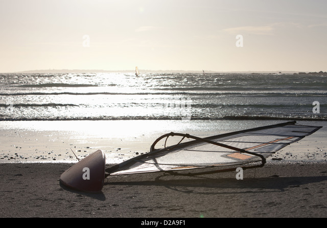 Wind sailing board on beach - Stock Image
