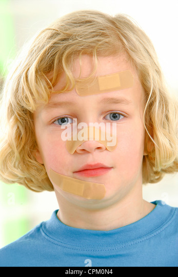 CHILD DRESSING - Stock Image