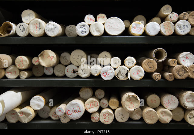 Maps stored in cardboard tubes in a records archive - Stock Image