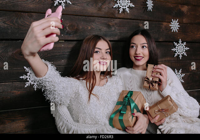 Two young girls make salfie - Stock Image