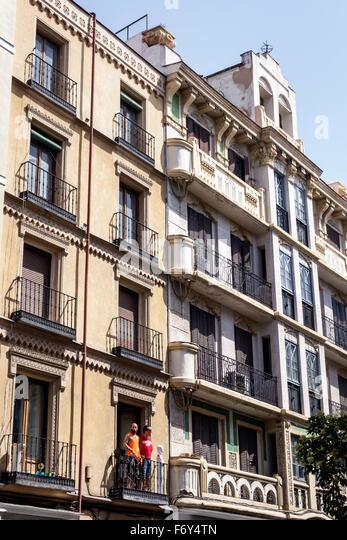 Spain, Europe, Spanish, Hispanic, Madrid, Centro, Chueca, Calle Hortaleza, residential apartment buildings, balconies, - Stock Image