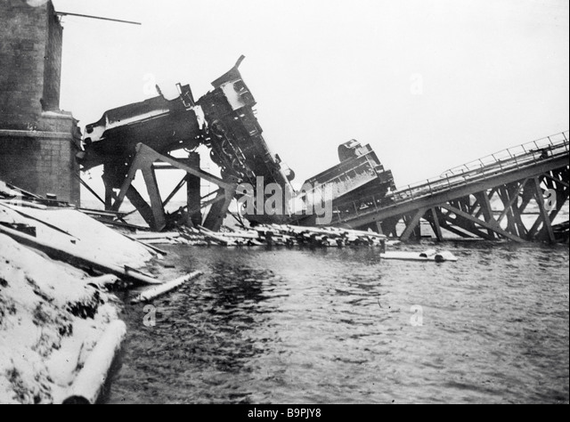 A destroyed railway train on a bridge blown up in the years of the Civil War - Stock Image
