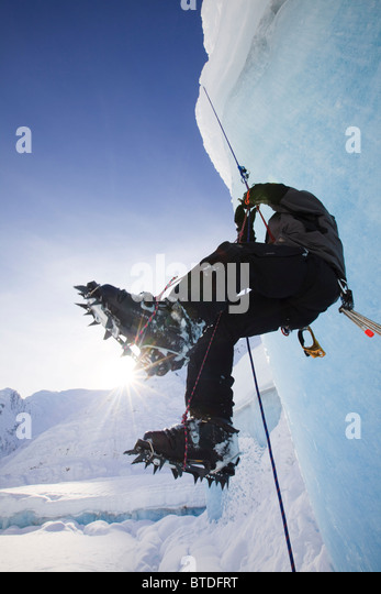 A man climbs a rope anchored on the top of Shakes Glacier, Stikine-LeConte Wilderness, Tongass National Forest, - Stock Image
