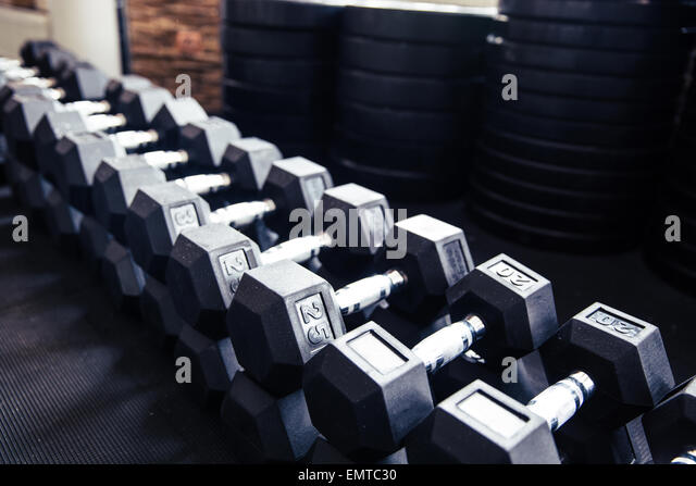 Closeup image of a dumbbells in fitness gym - Stock-Bilder