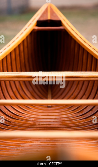 A shot down the length of a cedar canvas strip canoe. - Stock Image