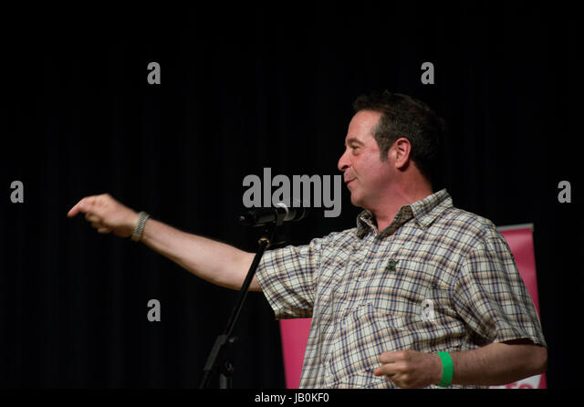 Comedian Mark Thomas speaking in the Town Hall at the 2017 Stoke Newington LIterary Festival - Stock Image