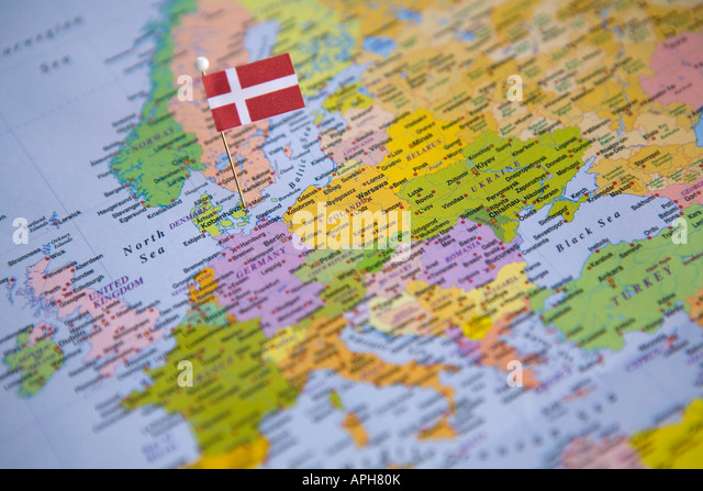 Flag Pin Placed on World Map in the Capital of Denmark Copenhagen - Stock Image