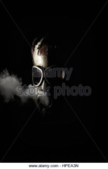 Man in a gas mask - Stock Image