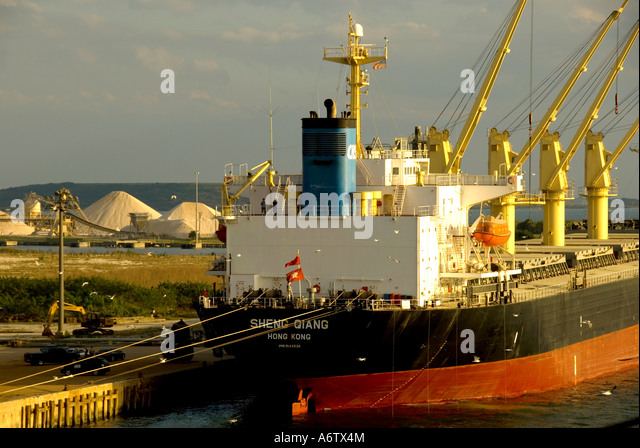 Tampa Bay Florida  Port of Tampa cargo ship yellow loading cranes open space text space copy space type space - Stock Image