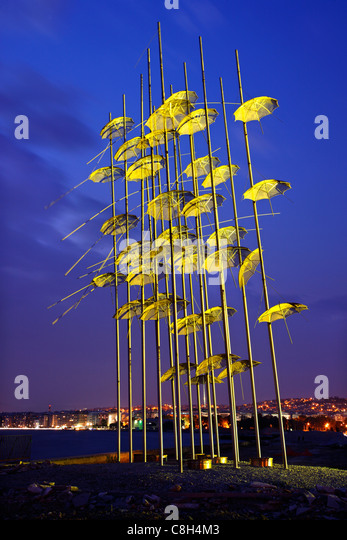 Greece, Thessaloniki. An artistic installation, called 'The Umbrellas' by George Zoggolopoulos, on the waterfront - Stock Image