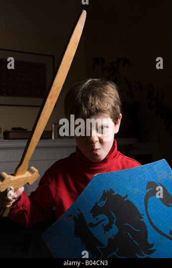 Boy with toy sword and shield - Stock Image