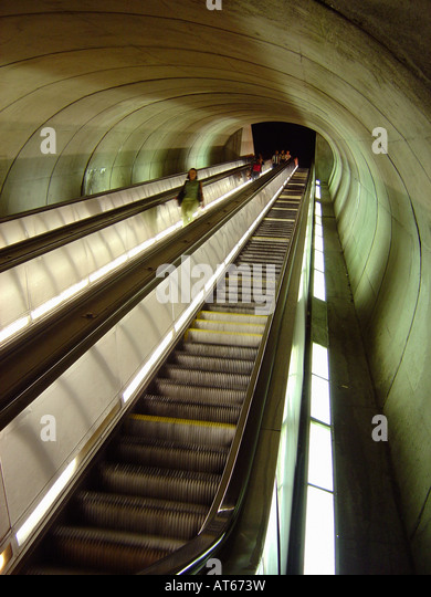 Commuters on the Very Long and Steep Escalators at Dupont Circle Subway Train Station in Washington DC USA - Stock Image