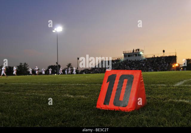 Football field at the 10th yard at night - Stock Image
