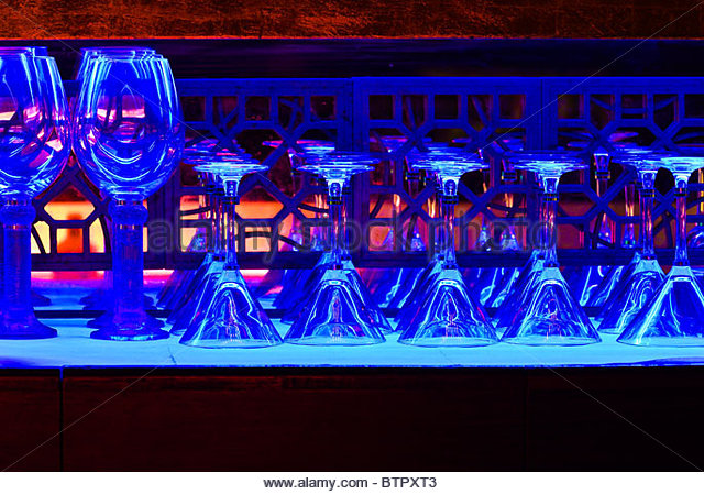 Colorfully lit bar of the TMSK Restaurant in the Xin Tian Di entertainment district, Shanghai, China - Stock-Bilder