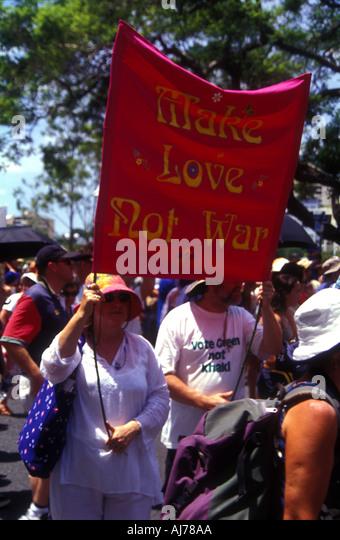 Make love not war protest poster banner Brisbane Queensland Australia Iraq invasion 2003 2406 - Stock Image