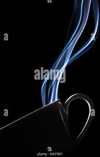 Steaming tea cup - Stock Image