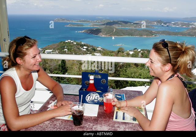 St. Thomas USVI Paradise Point women smile drink restaurant Charlotte Amalie Harbor Caribbean Sea - Stock Image