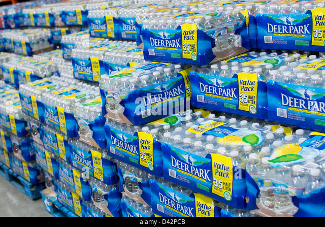 Deer Park bottled water on display at a Costco Wholesale Warehouse Club. - Stock Image