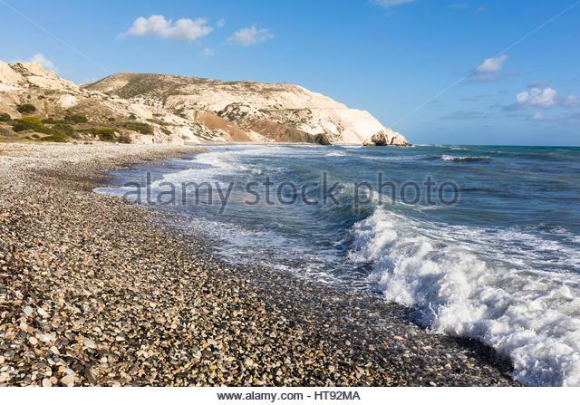 Surf on Pebble Beach at Petra tou Romiou, Paphos, Cyprus - Stock Image