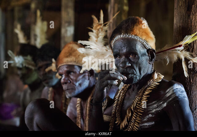 Headhunter of a tribe of Asmat in traditional dresses and painting. June 28, 2012, Jow Village, Asmat, Irian Jaya - Stock Image
