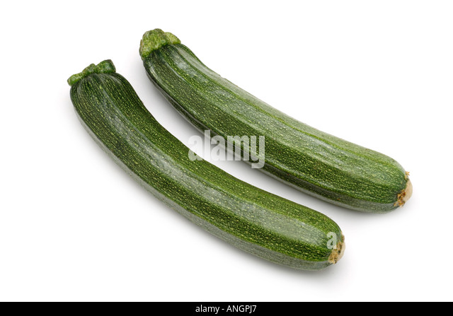 Courgettes zucchini on white background - Stock Image