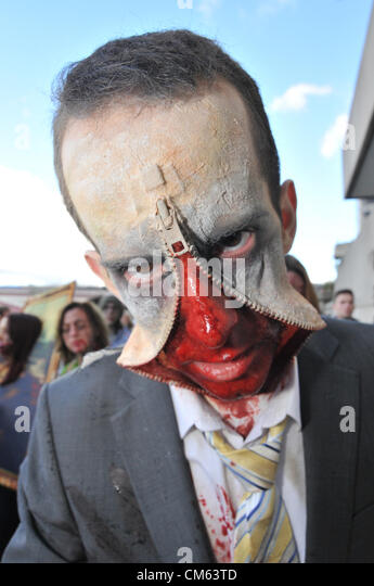 Southbank, London, UK. 13th October 2012. A zip faced 'Zombie' near the National Theatre. World Zombie Day, - Stock Image