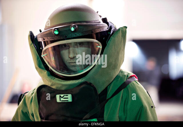 A US Air Force Staff Sgt. Cory Ahlf poses in an EOD-9 bomb suit November 5, 2014 in Loveland, Colorado. - Stock Image