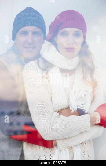 Happy couple in warm clothing - Stock Image