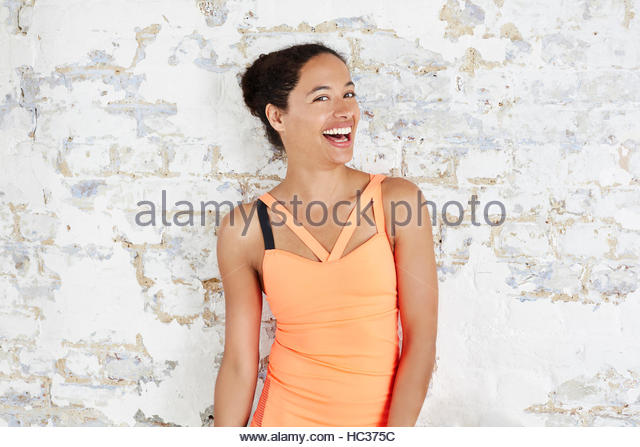 Portrait of woman in sportswear, laughing. - Stock Image