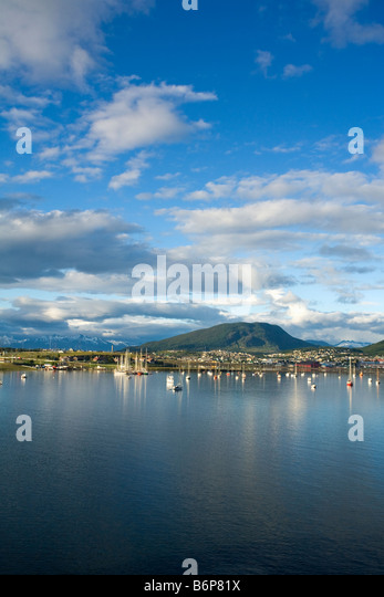 Ushuaia town and harbour in early morning light Tierra del Fuego Argentina South America - Stock Image