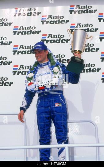 Rickard Rydell celebrates victory.British touring cars.Thruxton. Artist: Unknown. - Stock Image