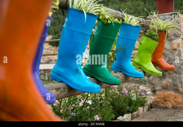 katiuskas converted in pots to decorate terraces - Stock Image