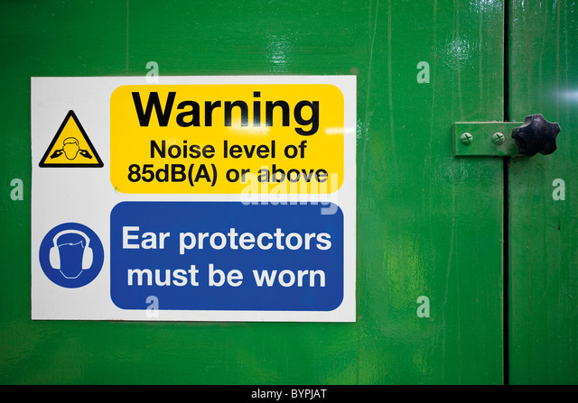 Sign warning of high levels of noise and the need to wear ear protectors - Stock Image