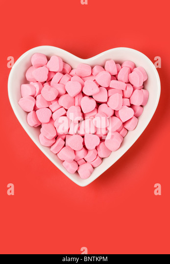 Pink Heart Shape Candy close up - Stock Image
