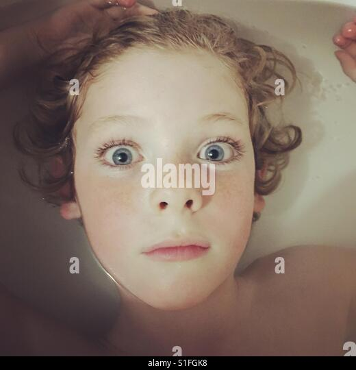 Portrait of boy in water. - Stock-Bilder