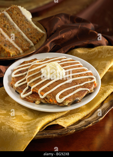 Carrot cake pancakes with icing and maple butter - Stock Image