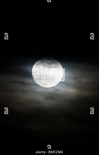 Full moon rises over the small mountain town of Salida, Colorado, USA - Stock Image