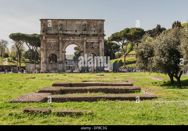 The Arch of Constantine (Arco di Costantino) is located in front of the Colosseum, Rome, Lazio, Italy, Europe - Stock Image