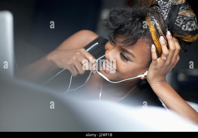 Young woman looking at her laptop - Stock Image