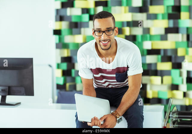 Man holding digital tablet in office - Stock Image