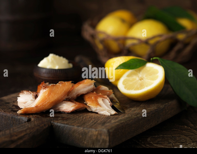 Pieces of mackerel with lemons and butter - Stock Image