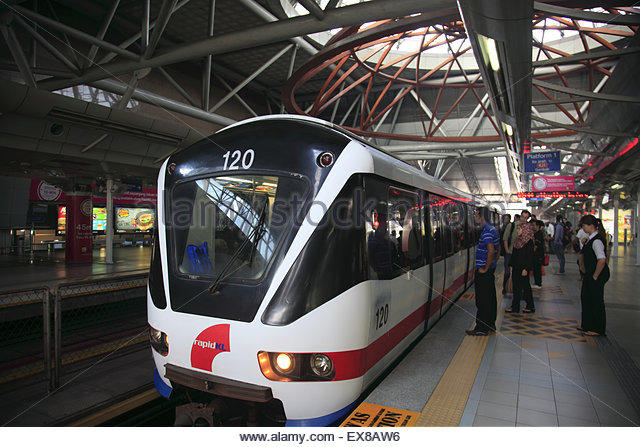 Malaysia, Train arriving on platform at Kuala lumpur. - Stock Image