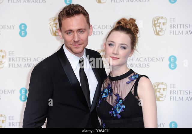 London, UK. Feb 10th, 2013. Tom Hiddleston and Saoirse Ronan pose in the press room at The EE British Academy Film - Stock-Bilder